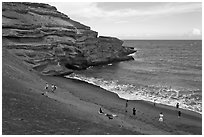People on Mahana (green sand) Beach. Big Island, Hawaii, USA (black and white)