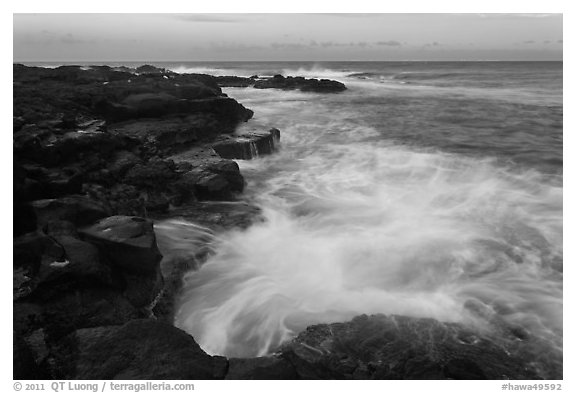 Surf and lava shoreline at sunset, South Point. Big Island, Hawaii, USA (black and white)