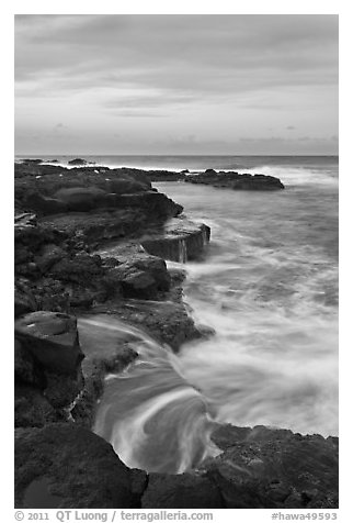 Surf and volcanic shore at sunset, South Point. Big Island, Hawaii, USA (black and white)