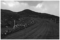 Unpaved road and volcanic landscape. Mauna Kea, Big Island, Hawaii, USA (black and white)