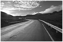 Road and cinder cones. Mauna Kea, Big Island, Hawaii, USA (black and white)