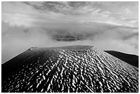 Cinder cone and sea of clouds at sunset. Mauna Kea, Big Island, Hawaii, USA (black and white)