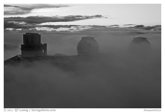 Telescopes, clouds, and fog at sunset. Mauna Kea, Big Island, Hawaii, USA (black and white)