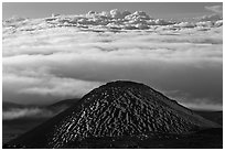 Dark cinder cone and sea of clouds. Mauna Kea, Big Island, Hawaii, USA (black and white)