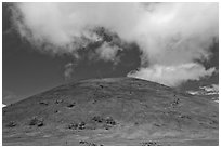 Cinder cone covered with grass, clouds. Big Island, Hawaii, USA (black and white)