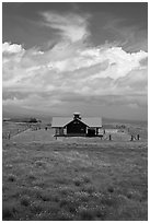 Rural building with bright red roof in ranchland. Big Island, Hawaii, USA ( black and white)