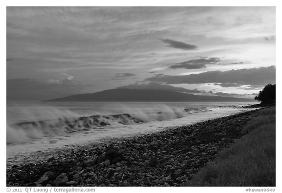 Lanai Island and crashing surf at sunset. Lahaina, Maui, Hawaii, USA (black and white)