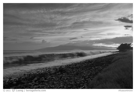 Crashing wave, Lanai Island, and colorful sunset clouds. Lahaina, Maui, Hawaii, USA (black and white)