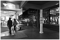 Couple entering art gallery. Lahaina, Maui, Hawaii, USA (black and white)