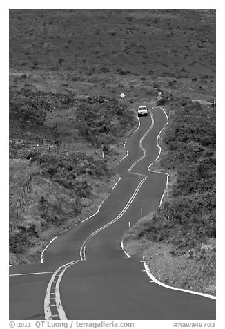 Car on winding Pilani Highway. Maui, Hawaii, USA (black and white)