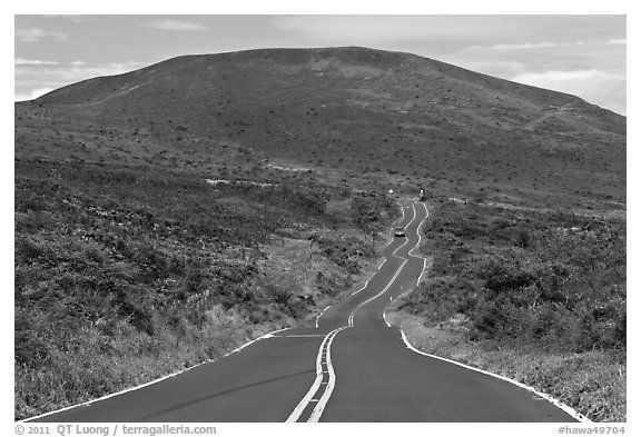 Winding road and hill. Maui, Hawaii, USA (black and white)