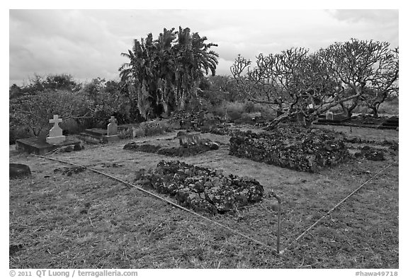 Graves made of lava rocks, Kaupo cemetery. Maui, Hawaii, USA (black and white)