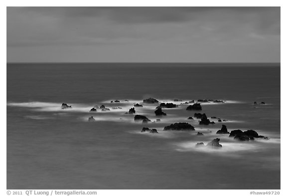 Offshore rocks in ocean. Maui, Hawaii, USA (black and white)