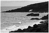 Dark coastline with sea tunnel. Maui, Hawaii, USA (black and white)