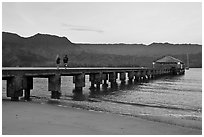 Conversation on Hanalei Pier. Kauai island, Hawaii, USA (black and white)