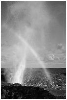 Spouting Horn with rainbow in spray. Kauai island, Hawaii, USA (black and white)