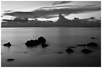 Rocks and cloud band, sunset. Kauai island, Hawaii, USA (black and white)