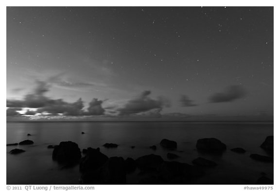 Rocks, ocean, and stars. Kauai island, Hawaii, USA (black and white)