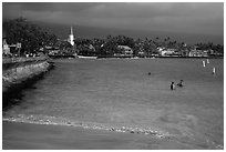 Beach, seawall and town, Kailua-Kona. Hawaii, USA (black and white)