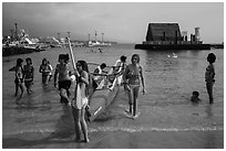 Girls and outrigger canoe, Kailua-Kona. Hawaii, USA (black and white)