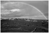 Rainbow over lava fields, Kalapana. Big Island, Hawaii, USA (black and white)