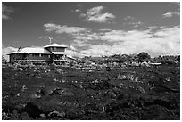 House and recently hardened lava. Big Island, Hawaii, USA (black and white)