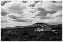 House built over fresh lava fields. Big Island, Hawaii, USA (black and white)