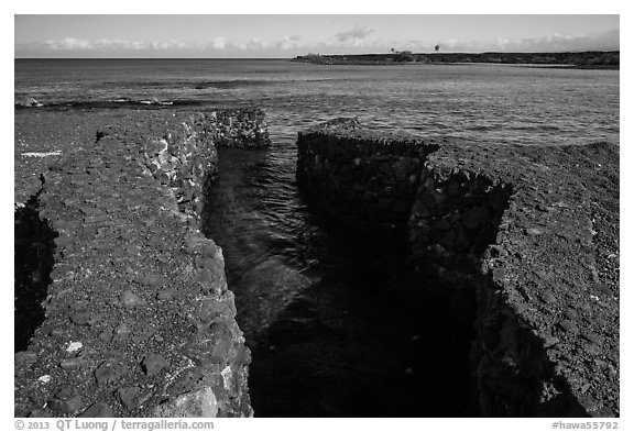 Walled stream flowing into Kiholo Bay. Big Island, Hawaii, USA (black and white)