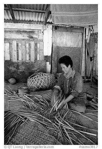 Woman weaving a toga (mat) out of pandamus leaves. American Samoa