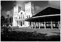 Church and fale in Leone. Tutuila, American Samoa (black and white)