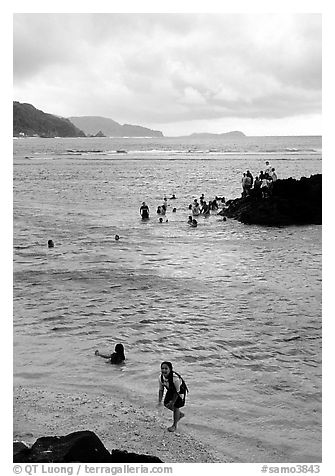 Children playing in water near Fugaalu. Pago Pago, Tutuila, American Samoa (black and white)