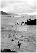 Children playing in water near Fugaalu. Pago Pago, Tutuila, American Samoa ( black and white)