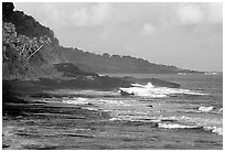 Fisherman on rocky coast near Vailoa. Tutuila, American Samoa (black and white)