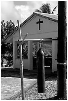 Gong and church, Aunuu village. Aunuu Island, American Samoa (black and white)