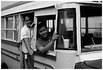 Women in a colorful bus. Pago Pago, Tutuila, American Samoa ( black and white)