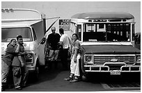 People and colorful buses. Pago Pago, Tutuila, American Samoa (black and white)