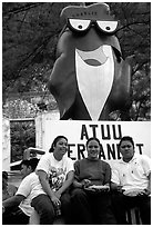 Women in front of statue of Charlie the Tuna. Pago Pago, Tutuila, American Samoa (black and white)