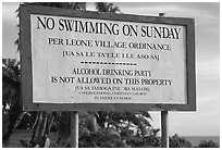 Sign prohibiting activities on Sunday. Tutuila, American Samoa (black and white)
