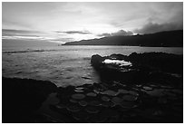 Ancient grinding stones (foaga) and Leone Bay at sunset. Tutuila, American Samoa (black and white)
