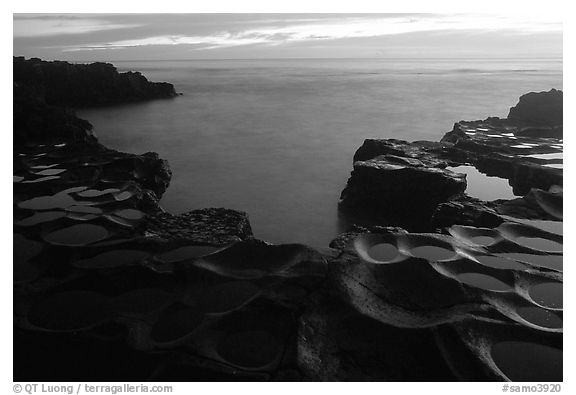 Ancient grinding stones (foaga) and Leone Bay at dusk. Tutuila, American Samoa (black and white)