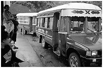 Colorful aiga busses, Pago Pago. Pago Pago, Tutuila, American Samoa (black and white)