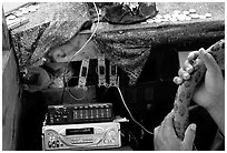 Hands of Aiga bus driver and sound system. Pago Pago, Tutuila, American Samoa ( black and white)