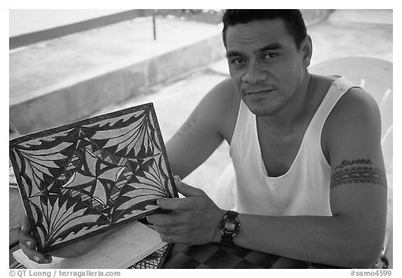 Young man showing an artwork based on traditional siapo designs. Pago Pago, Tutuila, American Samoa