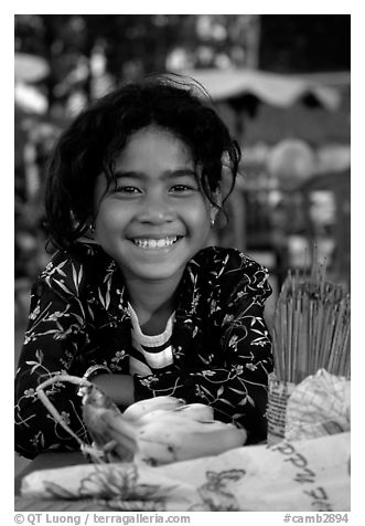Young incense vendor. Phnom Penh, Cambodia (black and white)