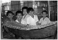 Boys with a traditional musical instrument. Phnom Penh, Cambodia ( black and white)