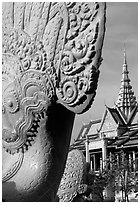 Statue and pagoda, Royal palace. Phnom Penh, Cambodia ( black and white)