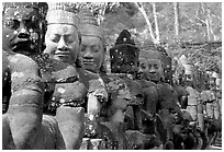 Statues near the gates of the temple complex. Angkor, Cambodia (black and white)