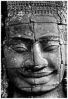 Enigmatic stone smiling face, the Bayon. Angkor, Cambodia (black and white)