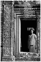Buddhist monk in doorway, the Bayon. Angkor, Cambodia (black and white)