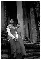 Elegant young women near temple entrance. Angkor, Cambodia (black and white)